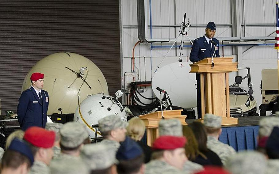 Col. Eric V. Faison speaks after accepting command of the 352nd Special Operations Maintenance Group at RAF Mildenhall, England, on Monday, March 23, 2015. The 352nd Special Operations Wing is set to move to Spangdahlem Air Base, Germany, in the next few years.  Adam L. Mathis/Stars and Stripes