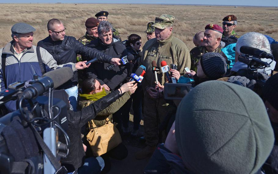 Lt. Gen. Ben Hodges, U.S. Army Europe commander, is interviewed by the Romanian media at the Smarden Training Area in Romania, on Tuesday, March 24, 2015, after watching the 173rd Airborne Brigade parachute into the training area.