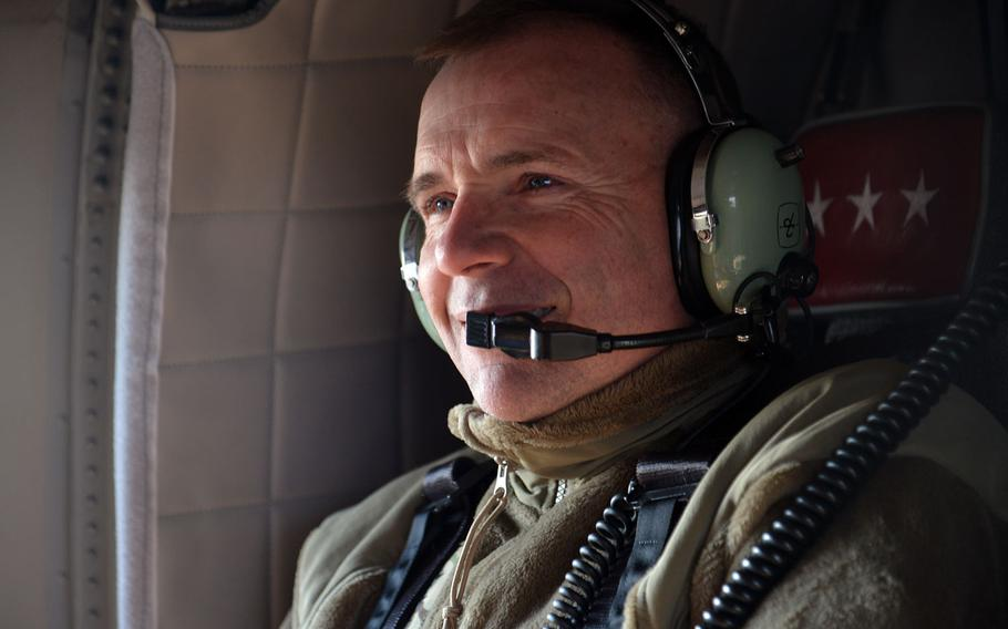 Lt. Gen. Ben Hodges flies in an U.S. Army UH-60 Black Hawk helicopter over Romania, after watching soldiers of the 173rd Airborne Brigade jump into the Smarden Training Area, on Tuesday, March 24, 2015.