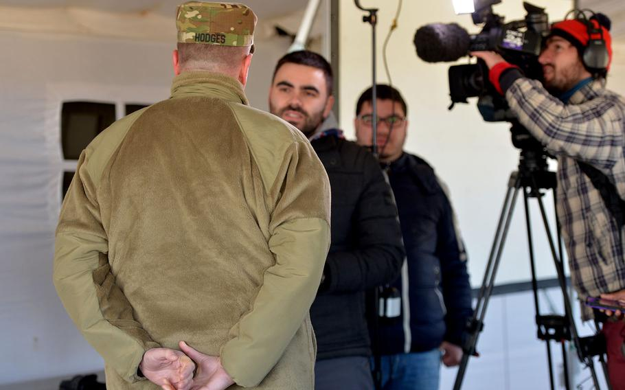 Lt. Gen. Ben Hodges, U.S. Army Europe commande, is interviewed by a Romanian television crew at the Smarden Training Area in Romania, on Tuesday, March 24, 2015, following a parachute jump by the 173rd Airborne Brigade.