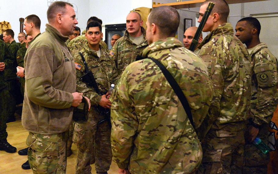 Lt. Gen. Ben Hodges, left, talks to soldiers of  Troop L, 3rd Squadron, 2nd Cavalry Regiment in Alytus, Lithuania, on Sunday, March 22, 2015. The soldiers had been training in Lithuania and were then taking part in the regiment's Dragoon Ride from Lithuania and Estonia to their home base in Vilseck, Germany.
