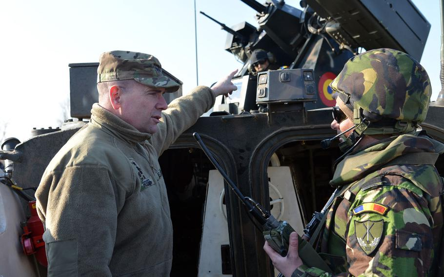 Lt. Gen. Ben Hodges, left, talks to a Romanian soldier about his armored vehicle at the Smarden Training Area in Romania, in March 2015. The U.S. is considering a plan to expand its military training of Ukrainian forces to include army soldiers, the commander of the U.S. Army in Europe said Monday, July 13, 2015.
