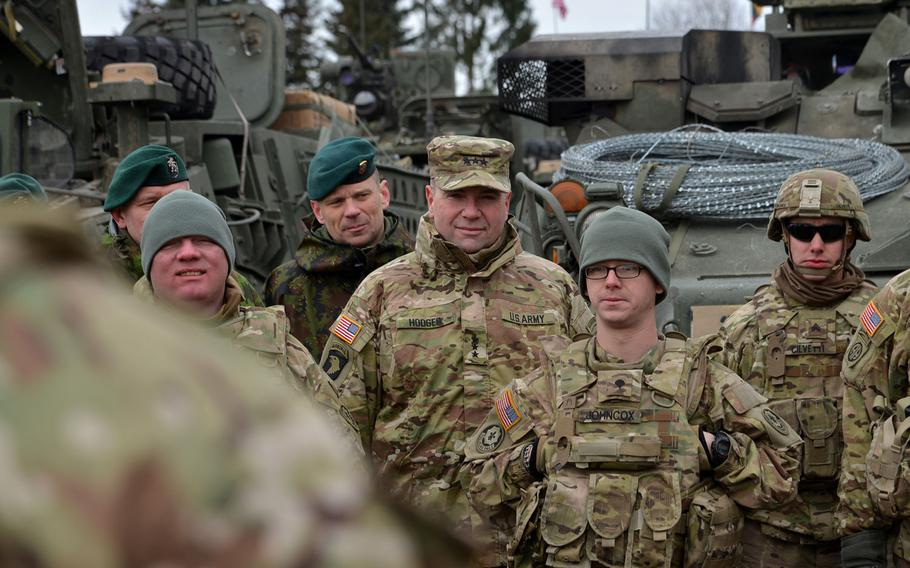 Lt. Gen. Ben Hodges, center, listens to a convoy brief in Alytus, Lithuania, onMonday, March 23, 2015. Hodges, U.S. Army Europe commander, and the soldiers of Troop L were preparing for 3rd Squadron, 2nd Cavalry Regiment's Dragoon Ride from Lithuania and Estonia to their home base in Vilseck, Germany.