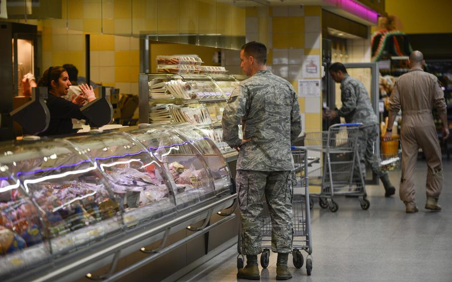 Customers shop at the commissary on Ramstein Air Base, Germany. A RAND study says raising prices in military commissaries to offset decreases in tax-payer dollars could be a bad idea.