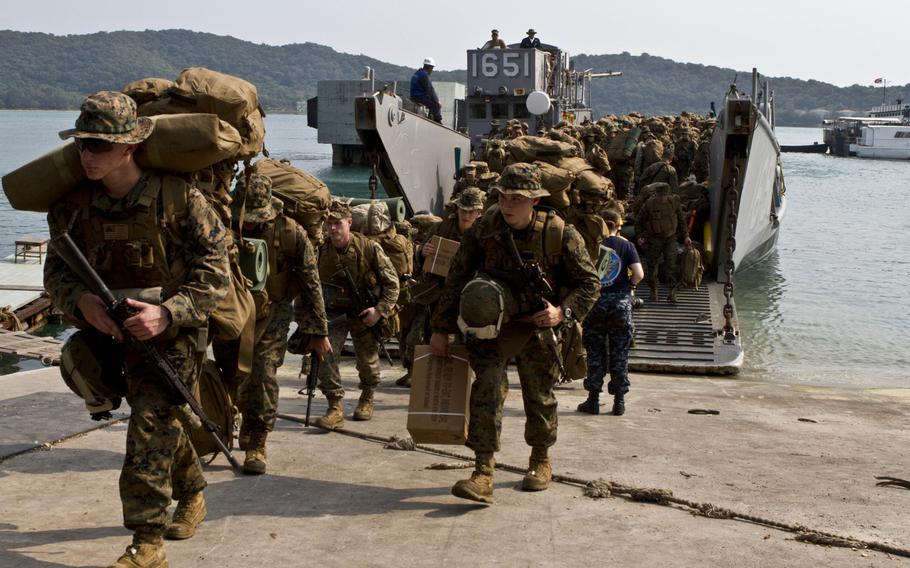 Marines and sailors from the 31st Marine Expeditionary Unit step off of a landing craft during their arrival for Cobra Gold 2013 exercise in Thailand. Before 2014's military coup in Thailand, the exercises were among the largest in the Pacific, but last year's training was truncated, and it's unclear what's in store for 2016.