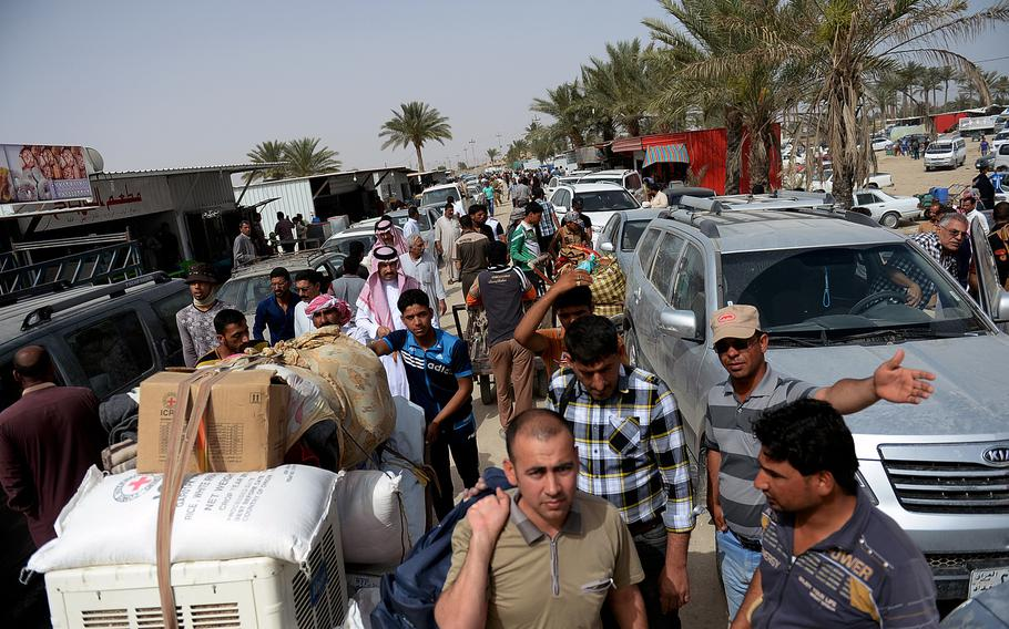 Thousands of people flee fighting between Iraqi forces and the Islamic State in Anbar province, Iraq, in April 2015. Fear of the group's brutality sent tens of thousands of people seeking safety in Baghdad and other areas.