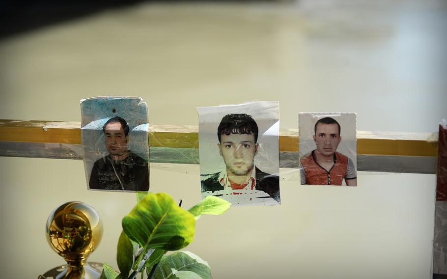 Photos of victims are placed at a memorial for hundreds of young Iraqi men executed by the Islamic State along the Tigris River in Tikrit.