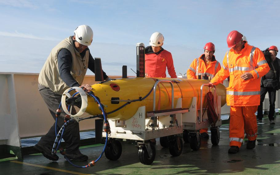 Crew members of the NATO research vessel NRV Alliance prepare to launch the first of two autonomous underwater vehicles in the North Sea off the coast of Norway on May 5, 2015. Programmed to track objects moving underwater, the devices are being tested by NATO's Centre for Maritime Research and Experimentation as part of a NATO anti-submarine warfare exercise, Dynamic Mongoose.