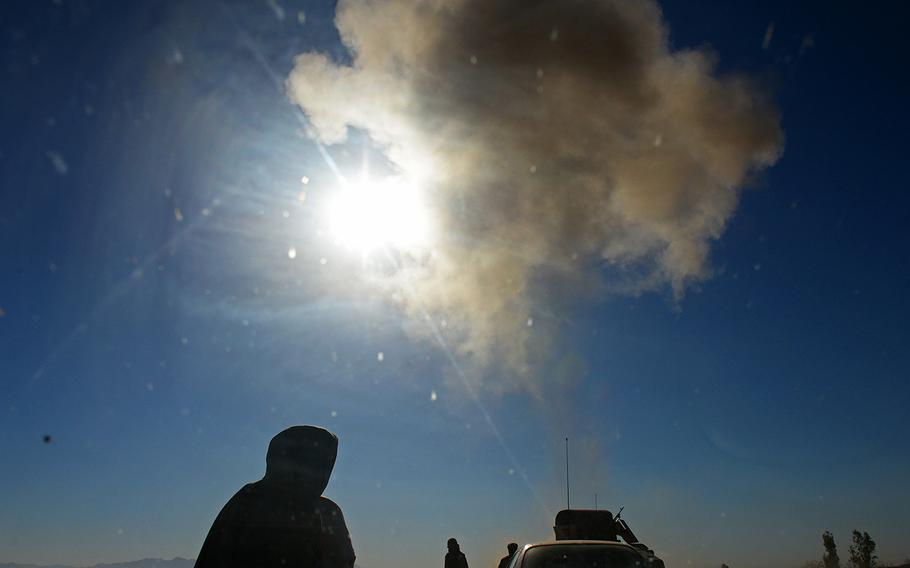 An improvised explosive device explodes on the highway between Camp Shorabak and the regional capial Lashkar Gah in Helmand province, May 15, 2015. Officials at Shorabak have abandoned counterinsurgency patrols to villages surrounding the base, and the Taliban continue to attack.