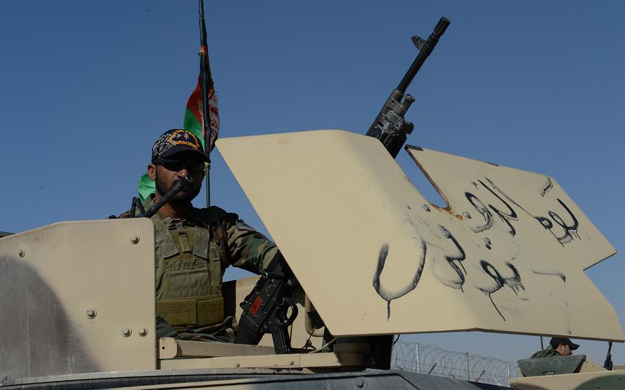 An Afghan special forces soldier with the army's 215 Corps waits in a Humvee's gun turret ahead of a patrol May 12, 2015 in Helmand province. This is the first fighting season for the soldiers without coalition forces in the province.