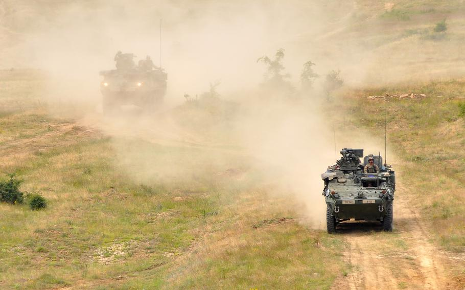 Strykers of 2nd Squadron, 2nd Cavalry Regiment roll across the Novo Selo Training Area, Bulgaria, Thursday June 25, 2015. Training at the base is set to increase in September, with the first of three planned six-month rotations of about 150 Marines.