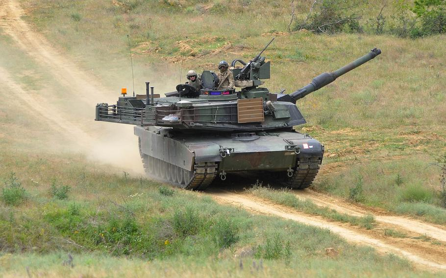 A U.S. Army M1A2 Abrams tank, manned by soldiers of the 3rd Combined Arms Battalion, 69th Armor Regiment, rumbles across Novo Selo Training Area, Bulgaria, following a live-fire exercise at the training area, Thursday June 25, 2015.   Training at the base is set to increase in September, with the first of three planned six-month rotations of about 150 Marines.