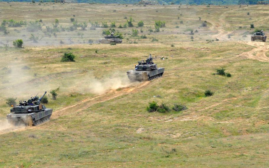 Two American M1A2 and two Bulgarian T-72 tanks rumble across the Novo Selo Training Area in Bulgaria during a live-fire exercise, June 25, 2015. Soldiers from 3rd Infantry Division are also set to arrive at the base this fall for a 90-day rotation.