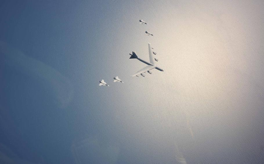 A U.S. Air Force B-52H Stratofortress leads a flight of four Swedish JAS-39 Gripens on June 11, 2015, during a Baltic Operations 2015 mission over the Baltic Sea. The aircraft took part in multiple missions throughout the exercise, including Mk-62 Quickstrike mine drops and naval support functions.