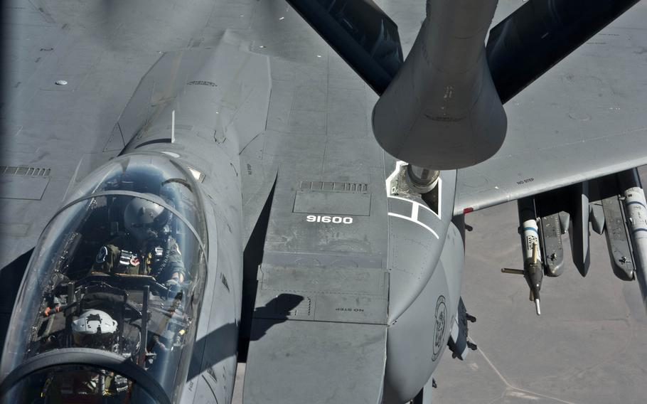 A pilot flying a F-15E Strike Eagle from Mountain Home Air Force Base, Idaho, looks over as a KC-135 Stratotaker from Fairchild AFB, Wash., prepares to refuel it during a mission on  June 25, 2015, over the Inland Northwest.