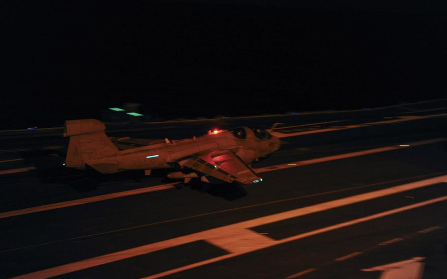 An E/A-6B Prowler assigned to the Garduas of Electronic Attack Squadron 87 lands on the flight deck aboard the Nimitz-class aircraft carrier USS George H.W. Bush February 3, 2015.