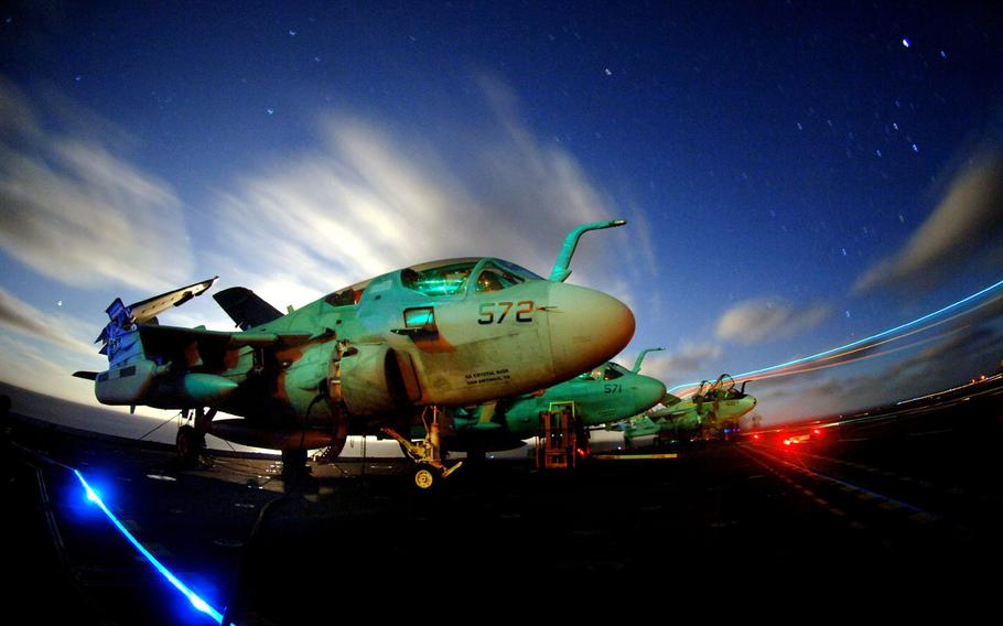 EA-6B Prowlers assigned to the ''Vikings'' of Tactical Electronic Warfare Squadron 129 sit chained to the flight deck aboard the Nimitz-class aircraft carrier USS John C. Stennis on March 16, 2006.