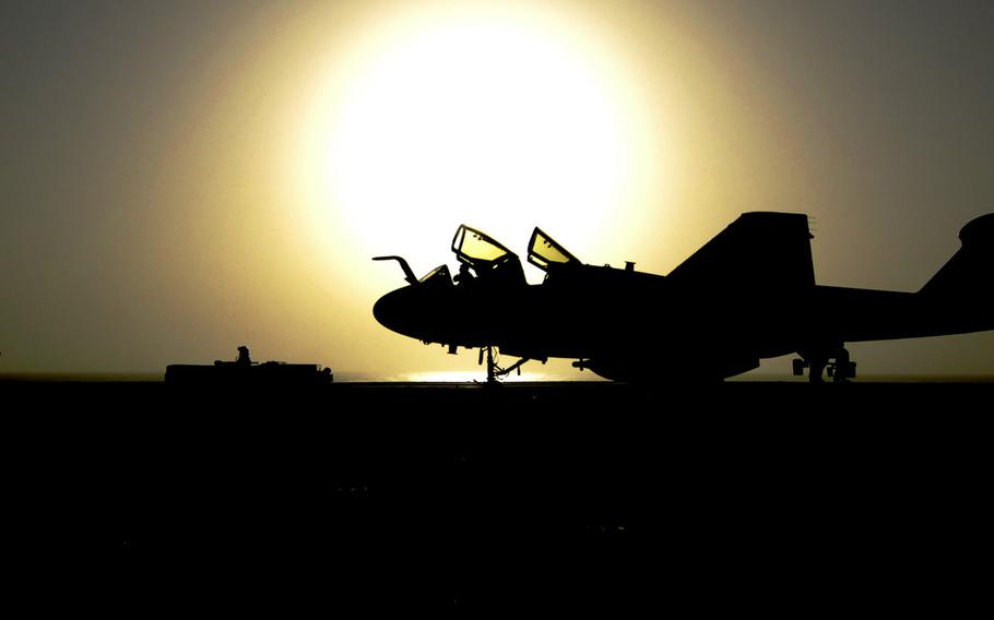 An EA-6B Prowler assigned to the ''Zappers'' of Electronic Attack Squadron 130 is towed across the flight deck of the aircraft carrier USS Harry S. Truman after completing flight operations August 1, 2010.