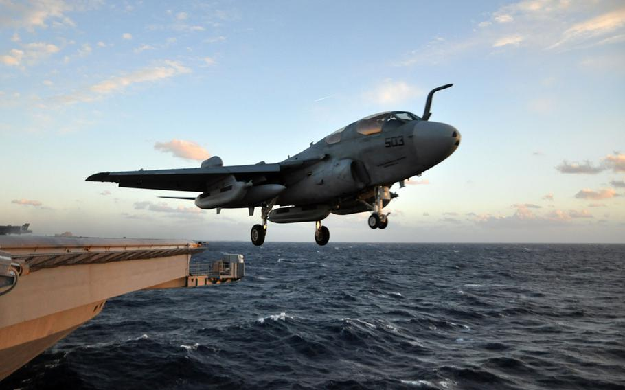 An EA-6B Prowler from the Patriots of Electronic Attack Squadron 140 launches from the Nimitz-class aircraft carrier USS Dwight D. Eisenhower December 5, 2012.