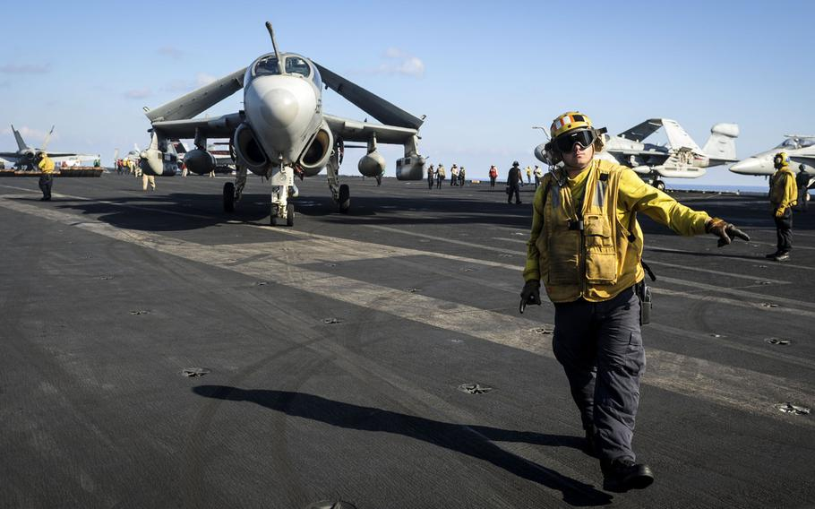 Aviation Boatswain?s Mate 1st Class Anthony White directs an EA-6B Prowler assigned to the ''Gray Wolves'' of Electronic Attack Squadron 142 across the flight deck of the aircraft carrier USS Nimitz on Ocbober 26, 2013.