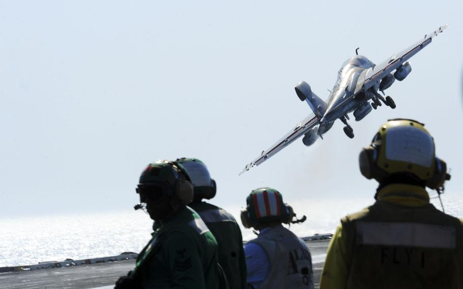 An EA-6B Prowler attached to the ''Garudas'' of Electronic Attack Squadron 134, takes off from the flight deck of the aircraft carrier USS George H.W. Bush on June 25, 2014.