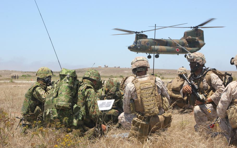 U.S. Marines and Japanese Self-Defense Force soldiers go over maneuver tactics while conducting amphibious assault operations on San Clemente Island on June 17, 2013. Japanese Prime Minister Shinzo Abe has been pushing for ''collective self defense,'' which would allow his country's military to defend its allies in the event of an attack.