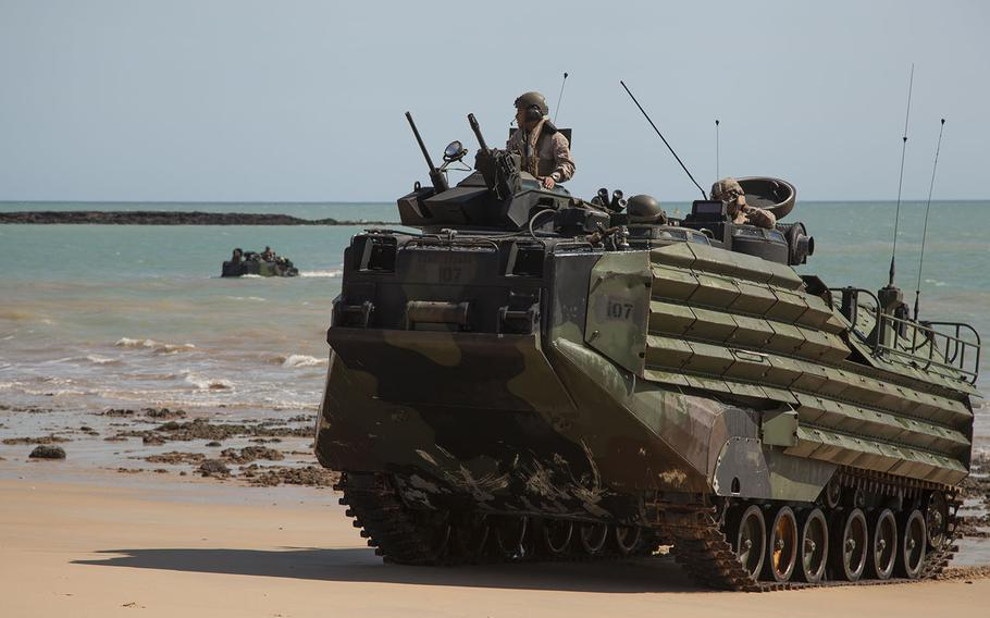 U.S. Marine Corps amphibious assault vehicles, assigned to the 31st Marine Expeditionary Unit, come ashore at Fog Bay, Australia, during exercise Talisman Sabre, July 8, 2015.