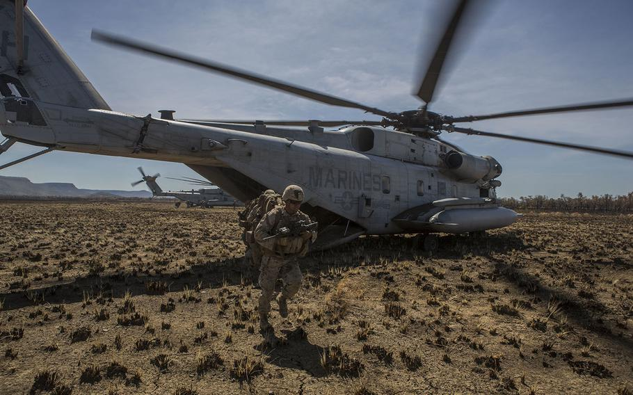 U.S. Marines with 1st Battalion, 4th Marine Regiment, exit a CH-53E Super Stallion Helicopter to prepare for a movement to contact exercise during the start of Exercise Talisman Sabre 15 on July 6, in Bradshaw, Northern Territory, Australia.