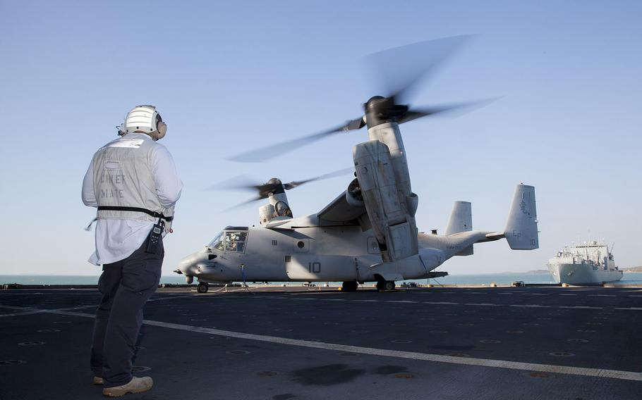 Crewmembers of the USNS Sacagawea conducts flight operations with a U.S. Marine Corps MV-22B Osprey, from Marine Medium Tiltrotor Squadron 265, 31st Marine Expeditionary Unit, during exercise Talisman Sabre 15, July 9, 2015.