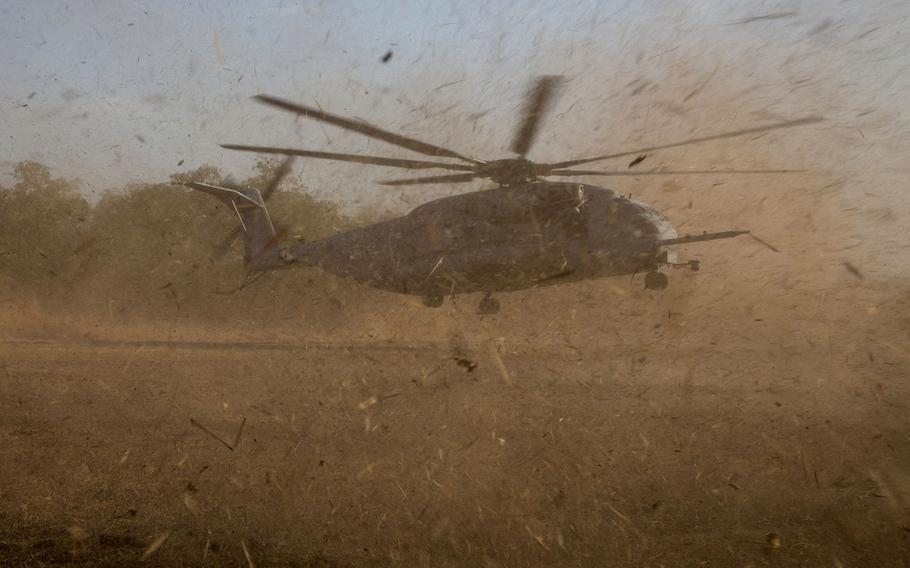 A U.S. Marine Corps CH-53E Super Stallion from Marine Medium Tiltrotor Squadron 265 (Reinforced), 31st Marine Expeditionary Unit, touches down at a landing zone while conducting a Tactical Recovery of Aircraft and Personnel during exercise Talisman Sabre 15 in Fog Bay, Northern Territory, Australia, July 9, 2015.