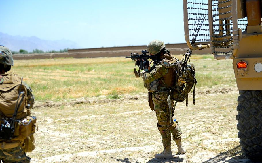 A member of the 43th Georgian Light Infantry Battalion scans the perimeter for threats during a force protection patrol outside Bagram Air Field in Parwan province, June 10, 2015.