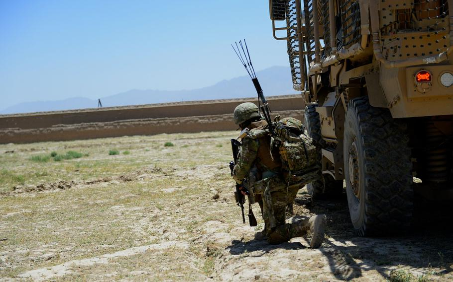 A Georgian soldier takes a defensive position during a June 10, 2015, joint force protection patrol with U.S. forces outside Bagram Air Field in Parwan province, central Afghanistan.