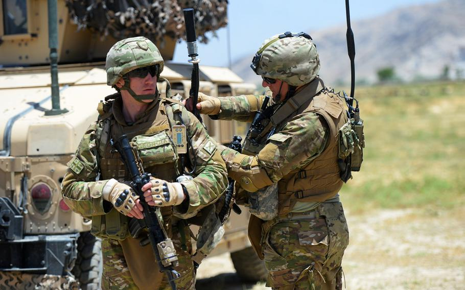 Georgian troops attached to 4th Light Infantry Battalion check communications gear before heading out on a June 10, 2015, force protection patrol outside Bagram Air Field in Parwan province.