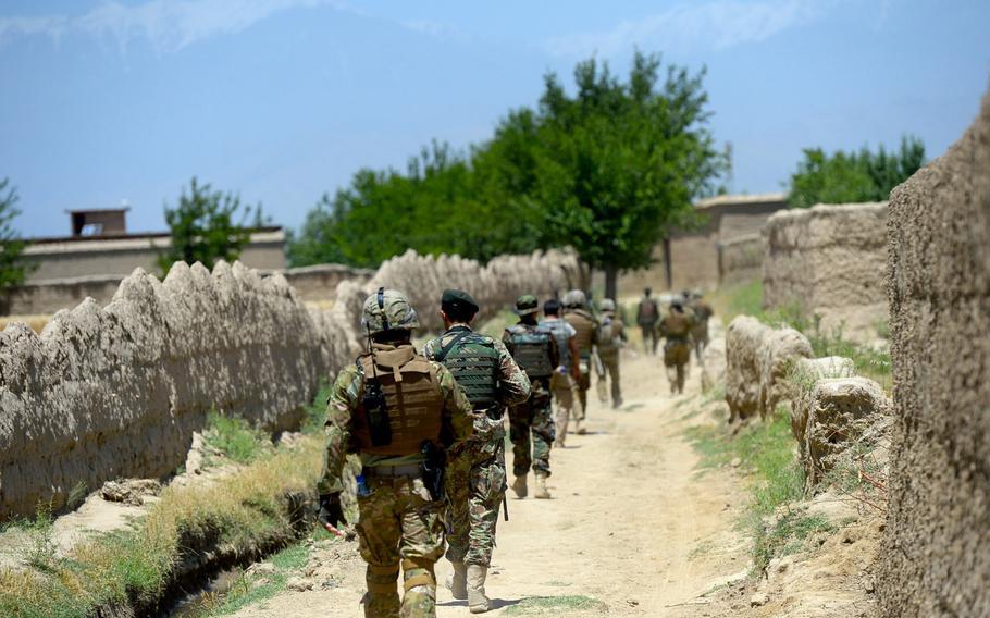 American, Afghan and Georgian troops head into a village during a June 10, 2015, security patrol outside Bagram Air Field in Parwan province, central Afghanistan.