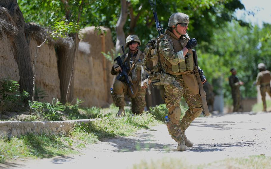 A member of the 43rd Georgian Light Infantry Battalion moves into position during a June 10, 2015, joint force protection mission with U.S. forces outside Bagram Air Field in central Afghanistan.