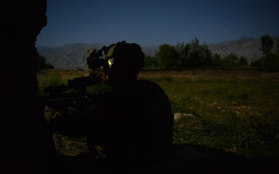 A Czech soldier with 4th Lion Company scans a suspected rocket launch site outside Bagram Air Field during a June 3, 2015, surveillance patrol with U.S. forces in Parwan province, central Afghanistan.