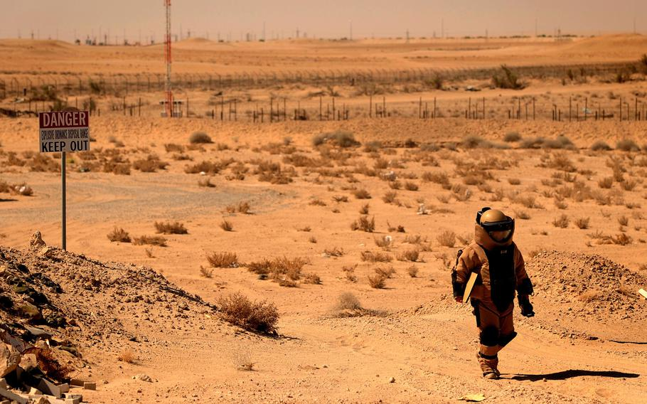 Tech. Sgt. Matthew Bingaman, a 386th Expeditionary Civil Engineer Squadron explosive ordnance disposal technician, returns from an improvised explosive device training scenario on Thursday, June 25, 2015, in Southwest Asia.