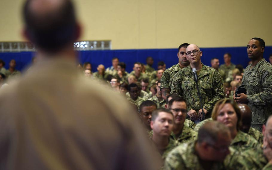 Sailors ask questions during an all-hands call with Chief of Naval Operations Adm. Jonathan Greenert in Bahrain, headquarters of 5th Fleet, on Monday,  July 13, 2015.