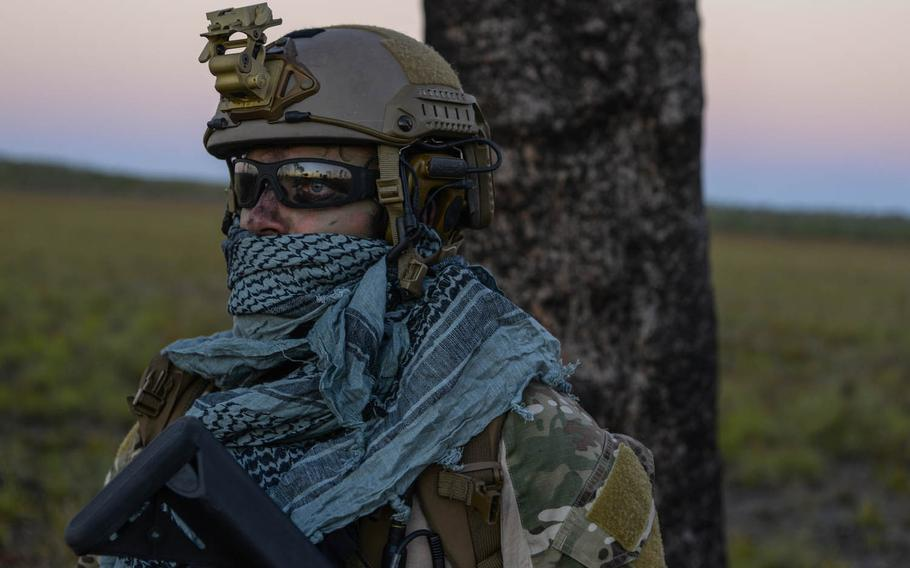 A special tactics combat controller from the 320th Special Tactics Squadron waits for the rest of his team to arrive after performing a high-altitude low opening jump during exercise Talisman Sabre in Northern Territory, Australia, on July 10, 2015. Talisman Sabre participants have the opportunity to further enhance their ability to respond to crises as part of a joint or combined effort.