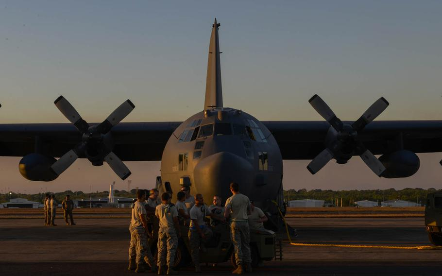 Members of the 353rd Special Operations Maintenance Squadron hang out before preparing an MC-130H Combat Talon II for takeoff during Talisman Sabre exercises in the Northern Territory of Australia, July 13, 2015.