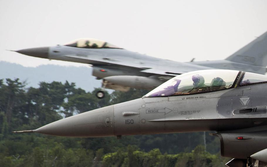 An F-16 Fighting Falcon from Kunsan Air Base prepares to take off as a South Korean KF-16 from Seosan Air Base, South Korea, lands in the background during an exercise on Aug. 20, 2014. The U.S. State Department has approved a possible $2.5 billion sale in F-16 upgrades to South Korea as part of Seoul's effort to revamp its aging fighter jet fleet. Congress has 30 days to block the sale.