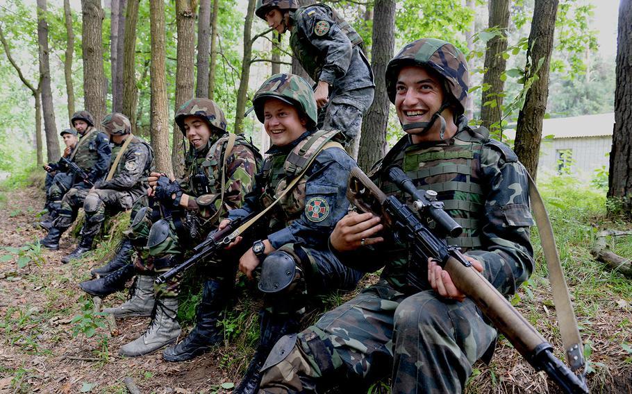 Ukrainian national guardsmen take a short rest during training with U.S. forces July 9, 2015, at a training base in Yavoriv, Ukraine.