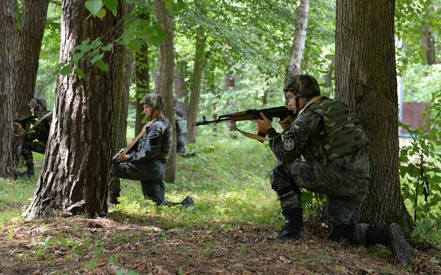 Ukrainian national Guardsmen post security at a simulated vehicle checkpoint July 9, 2015, at a training facility in western Ukraine. About 300 American paratroops in the country for training say they have been learning some conventional warfare tactics from their Ukrainian counterparts.