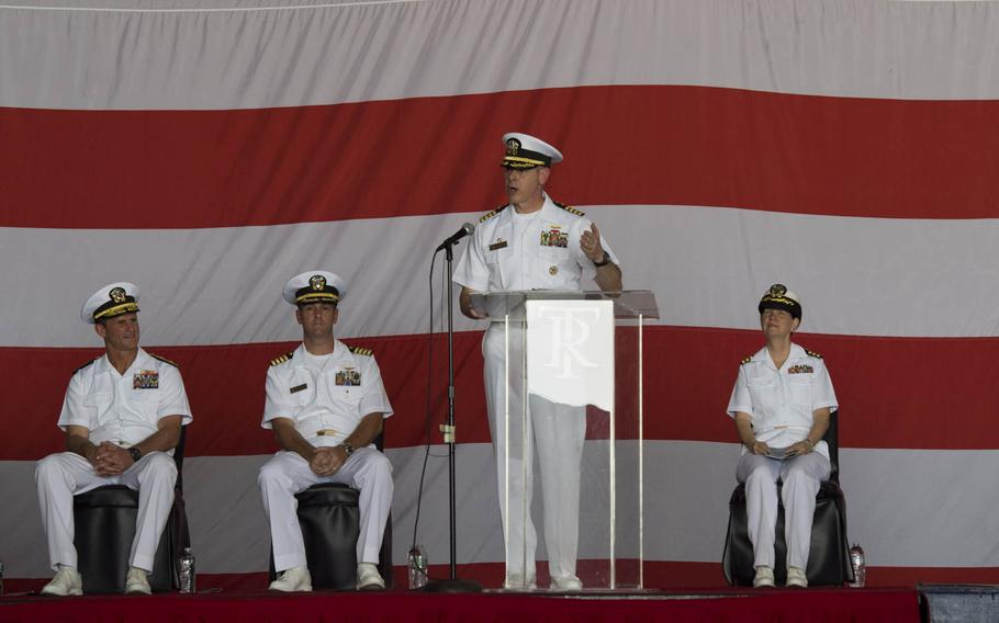 Capt. Daniel C. Grieco, outgoing commanding officer for USS Theodore Roosevelt, makes remarks during a change of command ceremony Tuesday,  July 21, 2015, in Bahrain. The ship is in Bahrain during a short break from an eight-month deployment in the Middle East.