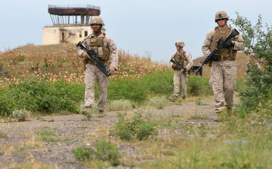 U.S. Marines go through a foot patrol drill at Agile Spirit 15, a training exercise in Vaziani, Georgia, Tuesday, July 14, 2015. The multinational exercise concluded Wednesday.
