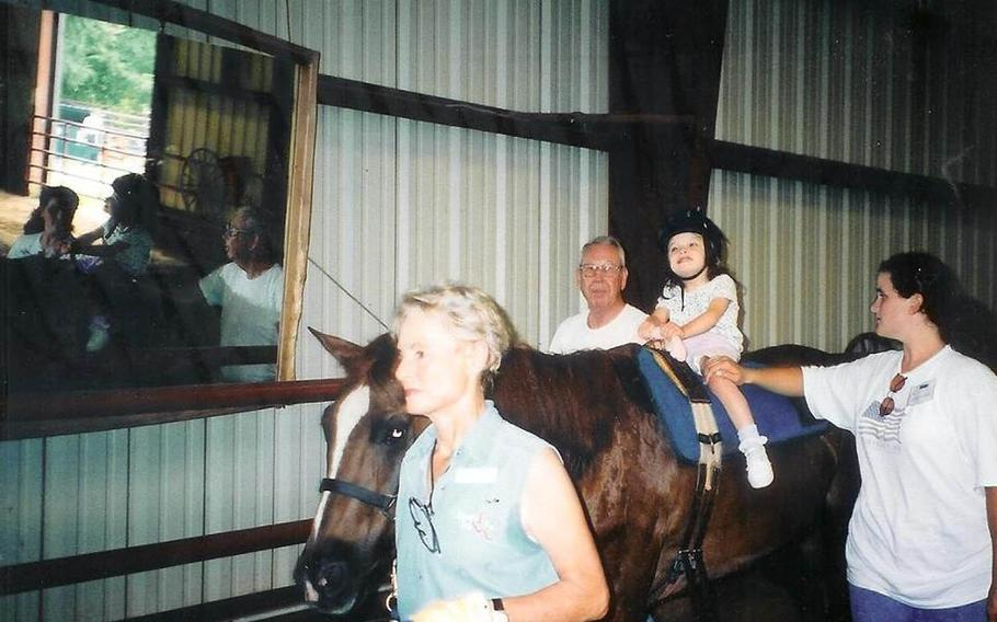 The Defense Department has agreed to a cash settlement with a retired Navy captain and his wife after the Defense Health Agency denied their daughter's Tricare claims for physical therapy using a horse, the family said July 23, 2015. Tricare notified the Samuels family in June 2010 that their daughter Kaitlyn's use of a horse during her physical therapy sessions was not covered because it constituted unproven treatment.