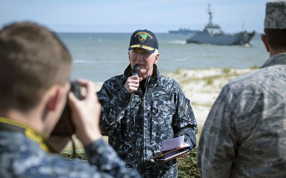 Vice Adm. James Foggo III, commander U.S. 6th Fleet and Naval Striking and Support Forces NATO, center, narrates to a group of NATO officers and leaders involved with exercise BALTOPS 2015, during an amphibious landing at the Ustka Training Range, Poland, June 17, 2015.
