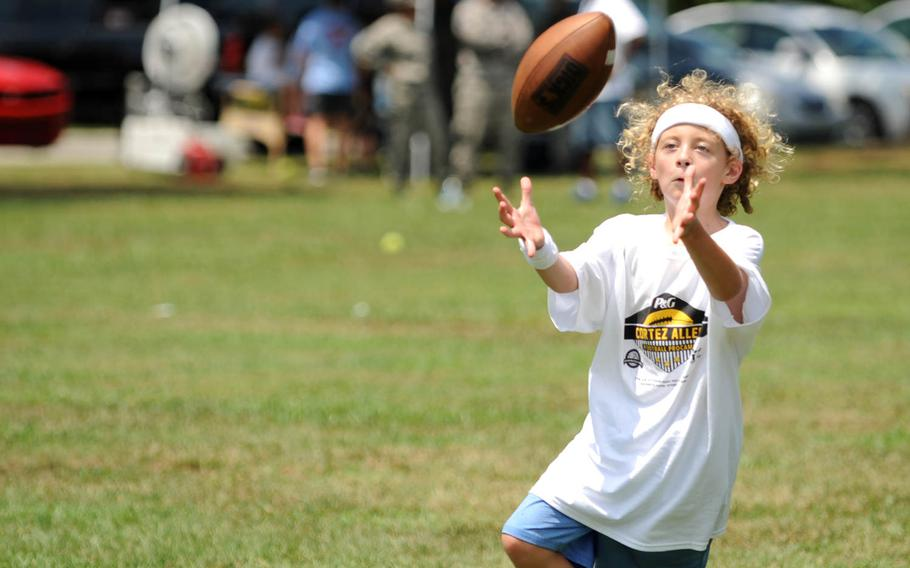 A future wide receiver lines up to snag a pass during a National Football League ProCamp, on Thursday, July 16, 2015, at Seymour Johnson Air Force Base, N.C. ProCamps are held all over the U.S., and internationally, to give children a chance to train with professional athletes.