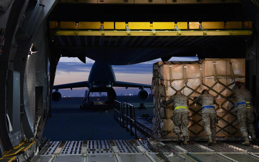 APEX students offload a pallet of household goods on Tuesday, July 7, 2015 onto a 60K tunner at Travis Air Force Base, Calif. Students were required to complete a minimum of 36 hours of hands-on training as part of the APEX training course.