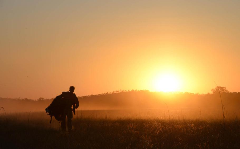A special tactics special operation weatherman from the 320th Special Tactics Squadron carries his parachute and gear after performing a HALO jump during exercise Talisman Sabre in Northern Territory, Australia, on Friday, July 10, 2015.   Stephen G. Eigel/U.S. Air Force